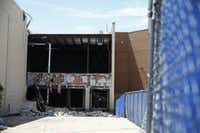 The exterior of a teardown of Saks Fifth Avenue at the Shops at Willow Bend in Plano on Aug. 25. About 70 percent of the metal, concrete and carpet is going to recyclers instead of a landfill, said developer Starwood Retail Partners.  (Nathan Hunsinger/Staff Photographer)
