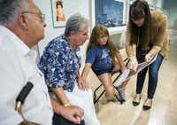 Alan and Hope Levine and their granddaughter Gretchen Jones, 9, looks at a photo of artwork from ancient Greece held by teaching specialist Jennifer Sheppard (right) as part of the Meaningful Moments Program for individuals with early stages of dementia at the Dallas Museum of Art. (Ashley Landis/Staff Photographer)