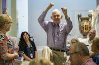 Dick Bernet makes a pole vaulting motion during a presentation on the Olympics and ancient Greece as part of the Meaningful Moments Program for individuals with early stages of dementia on Tuesday, August 16, 2016 at the DMA.(Ashley Landis/Staff Photographer)