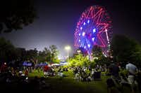 Spectators waited for the fireworks show to begin near the Texas Star ferris wheel during the Fair Park Fourth celebration this year. ((Smiley N. Pool/Staff Photographer))