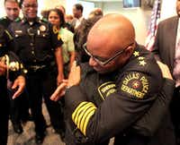 Brown and Dallas County Sheriff Lupe Valdez embraced on April 4, 2010, shortly after Brown was sworn in as the new police chief. (File Photo/Staff)(<p><br></p><p></p>)