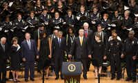 President Barack Obama joined hands with Mayor Mike Rawlings and other dignitaries during a memorial service at the Meyerson Symphony Center for the five law enforcement officers killed in the July 7 Dallas ambush. (Smiley N. Pool/Staff Photographer)(<p><br></p><p></p>)
