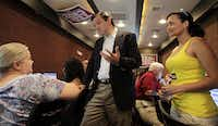 As a candidate for Senate in May 2012, Ted Cruz made a stop at the Tea Party Express mobile phone bank on a bus in a hotel parking lot in Richardson, Texas. Katrina Pierson, right, of Garland, was a volunteer at the event.(David Woo/Staff photographer)