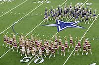 Drill teams from two Frisco high schools, Heritage and Lone Star, performed simultaneously during halftime of one of four high school football games played at The Star on Aug. 27. (Vernon Bryant/The Dallas Morning News)