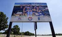 A sign advertises where the new Texas Live! entertainment venue will be built across from Globe Life Park in Arlington. (Tom Fox/The Dallas Morning News)