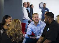 Participants chat during an event by Cornbread Hustle, a staffing agency that places released convicts. (Ashley Landis/The Dallas Morning News)(Staff Photographer)