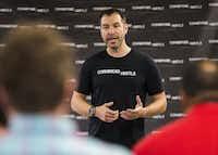 Michael Elliott speaks to an entrepreneurship class. (Ashley Landis/The Dallas Morning News)(Staff Photographer)