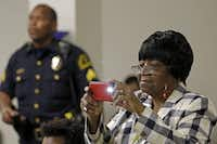 Edna Pemberton photographed speakers during Law Enforcement Appreciation Day at Southwest Center Mall in Dallas in May. (File Photo/Staff)