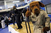 "McGruff the crime dog made an appearance as Dallas Police Chief David Brown held the first ""Chief on the Beat"" community engagement meeting, an attempt to prevent crime and make health and social services available to residents, in 2012.(File Photo/Staff)"