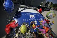A Lancaster police car was decorated in memory of slain police Officer Craig Shaw in Lancaster in June 2010. David Brown Jr., the 27-year-old son of Dallas Police Chief David Brown, was the shooter in the deaths of the officer and another man. (LM Otero/The Associated Press)