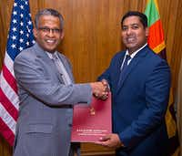 <br>(L, Sri Lanka Ambassador to the United States Prasad Kariyawasam recognizes Honorary Consul Shan Halamba. Courtesy.)