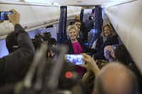 Hillary Clinton, the Democratic presidential nominee, greets reporters on her campaign jet.(Doug Mills/The New York Times)