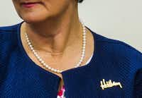 Anne Holton's Hillary pin.(Ashley Landis/Staff Photographer)