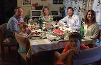 Texas Attorney General Ken Paxton (left)  and his wife, Angela, join the Briggle family — Adam, Amber and their children Lulu (next to Paxton) and MG —  for dinner in Denton. (Courtesy Photo)