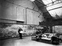 "Monet at work in his large studio, 1910. From ""Mad Enchantment,"" by Ross King.(Getty)"