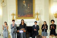 First lady Michelle Obama hosts a poetry reading in honor of the 2016 National Student Poets. From left: Maya Salameh, Joey Reisberg, Gopal Raman, Maya Eashwaran and Stella Binion were honored in the State Dining Room of the White House on Thursday.(Kevin Wolf/AP Images for Alliance for Young Artists & Writers)
