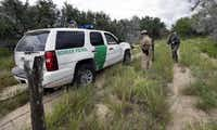 U.S. Customs and Border Protection agents confer as they patrol near McAllen in South Texas. (File Photo/The Associated Press) (<p><br></p><p></p>)