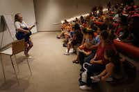 A music therapist leads families through songs about the Dallas Museum of Art's works at one of the Autism Awareness Family Celebrations.(Dallas Museum of Art<br>)