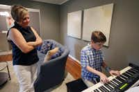 """<p>Rachel Schulze listens to her son Dennis play George Gershwin's """"Rhapsody in Blue."""" The 14-year-old has perfect pitch and started playing the piano with both hands during his third lesson.</p>(Ben Torres/Special Contributor)"""