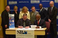 "Officials from the U.S. Small Business Administration and the North Texas GLBT Chamber of Commerce signing a partnership agreement at UNT Dallas College of Law.(<p><span style=""font-size: 1em; line-height: 1.364; background-color: transparent;"">Darla Booker / SBA</span></p>)"