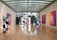 "<p>The ""Run for President"" installation by Kathryn Andrews at the Nasher Sculpture Center. On the floor are variations of three works: <i>Bozo the Clown Runs for President</i>, 1984, photograph by Larry Harmon Pictures Corp.  On the floor are three variations of the piece: ""Bozo, the World's Most Famous Clown"" Bop Bag with Occasional Performance. From left, (Black Variation), 2014, aluminum, vinyl, polyurethane, chrome-plated steel, and performance; (Pink Variation), 2014, aluminum, vinyl, polyurethane, chrome-plated steel, and performance; and (Blue Variation), 2014, aluminum, vinyl, polyurethane, chrome-plated steel, and performance. (Nan Coulter/Special Contributor)</p>"