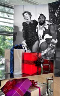 """First Lady Nancy Reagan and Mr. T at the White House Christmas Party,"" 1983 (Bettmann/CORBIS) and ""Gift Cart,"" 2011 by Kathryn Andrews, stainless steel and rented props. (Nan Coulter/Special Contributor)"