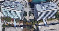 This Google Maps image shows the Siemens building on the left at 5800 Granite Parkway with cell towers attached at the top.