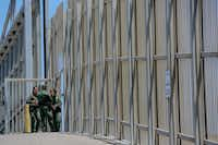 US Customs and Border Protection agents patrol the United States-Mexico Border wall at Friendship Park in San Ysidro, Calif. (Sandy Huffaker / AFP)