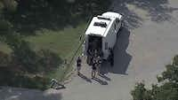 FBI agents were at the scene where a body was found burned and dismembered near Grapevine Lake.(KXAS-TV (NBC5))