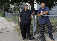 Ronnie Mestas (right), president of West Dallas 1, and Raul Reyes stand in front of Mestas's home. They believe the best way to take care of the neighborhood is to back its public schools.(David Woo/Staff Photographer)