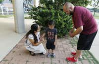 Dulce Fiscal, a primary assistant teacher at Lumin Wesley-Rankin Community School in West Dallas, consoles 3-year-old Isaac as his father, Antonio Valdez, drops him off at school.(David Woo/Staff Photographer)