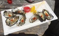 "<p>Iron Horse Vineyards serves $<span style=""font-size: 1em; line-height: 1.364; background-color: transparent;"">3 locally grown Miyagi oysters.</span></p>(Sheryl Jean)"