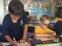 "Alec Gonzalez and Corbin Kroeker are partners during a math exercise. They are enrolled in the dual-language program available to all second grade students in the El Paso Independent School District. (<p><span style=""font-size: 1em; background-color: transparent;"">(Angela Kocherga)</span><br></p><p></p>)"