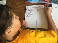 "A second-grade student works to solve math problems during a lesson taught in Spanish.  Dual-language students in the El Paso Independent School District spend half the school day learning in English, half in Spanish. (<p><span style=""font-size: 1em; background-color: transparent;"">Angela Kocherga</span><br></p><p></p>)"