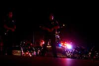 Police officers block the street at the scene where two officers were shot in the Wedgwood area of Fort Worth on Friday night. (Lawrence Jenkins/Special Contributor)