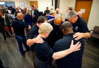 Fort Worth Police Chief Joel Fitzgerald (center, with glasses) joined members of the City of Fort Worth Clergy and Police Alliance in prayer for the injured officers at John Peter Smith Hospital in Fort Worth. (Tom Fox/Staff Photographer)