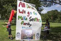 Youngsters sell lemonade and cookies in Prairie Creek Park to raise money for the family of Dallas Police officer Mike Smith just days after he was killed in an ambush in downtown Dalla(Smiley Pool/The Dallas Morning News)