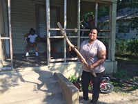 Netra Reese, shown in June 2016, keeps this stick by the porch of her Dallas home for protection from the large aggressive dogs who lived across the street and frequently escaped from the backyard to terrorize her and her neighbors – before they allegedly killed Antoinette Brown. (Naomi Martin/Staff Writer)(Staff writer)