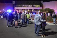 People stand near the entrance on the north side of Crossroads Center in St. Cloud, Minn. Several people were taken to a hospital with injuries after a stabbing attack at the mall, which ended with the suspected attacker dead inside. (Dave Schwarz/St. Cloud Times)
