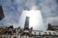 The 37-story skyscraper at 20 Fenchurch Street in London, where it came to be known as the Walkie-Talkie building, was once under fierce attack because of how it reflects bright sunlight onto areas below. It was blamed for melting a Jaguar parked on the street. Its glare, however, was soon fixed.(File Photo/The Associated Press)
