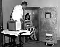 A woman sits in an orgone accumulator, designed by Wilhelm Reich to channel the omnipresent libidinal life force. (Wilhelm Reich Museum)