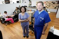 "<span style=""font-weight: normal;"">Maryam Raza, medical director for the wound care and hyperbaric medicine at Methodist Medical Center,  with Richard Galperin, doctor of podiatric medicine, at Nail MD in Dallas. (Ben Torres/Special Contributor)</span>"