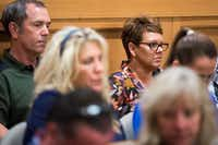 Christina Morris' parents, Mark Morris and Jonni McElroy, sat in the back row of the courtroom waiting for the verdict to be announced in the aggravated kidnapping case.(Smiley N. Pool/The Dallas Morning News)