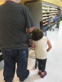 <p>A young girl is pulled by her hair at a Wal-Mart in Cleveland, Texas. (Erika Burch)</p>