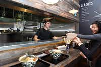 Christian Koelling delivers a bowl to customers at Ten in DallasSpecial Contributor