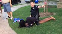 McKinney police Officer Eric Casebolt warns others away as he kneels on a female teen as he handcuffs her after throwing her to the ground.YouTube