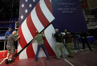 Workers install the set for the first presidential debate at Hofstra University.(Getty Images/Win McNamee)