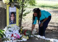 In this July 21, 2015 photo, Jeanette Williams places a bouquet of roses at a memorial for Sandra Bland near Prairie View A&M University. (AP Photo/Pat Sullivan, File)(AP)