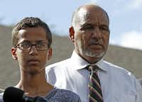 Ahmed Mohamed stands with his father Mohamed Elhassan Mohamed during a news conference on September 16, 2015 in Irving, Texas. The news converence, held outside the Mohammed family home, was hosted by the North Texas Chapter of the Council on American-Islamic Relations. (Ben Torres/Getty Images)