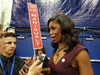 Omarosa Manigault, former contestant on <i>The Apprentice</i>, spins for Donald Trump at the Hofstra debate.(Todd J. Gillman/Staff)
